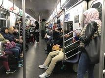 Люди в поезде в метро стоковая фотография rf