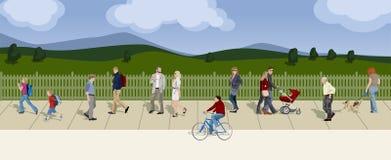 Люди гуляя на заднем плане поле Стоковые Фото