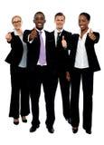 Люди команды дела собирают gesturing большие пальцы руки вверх стоковое фото rf