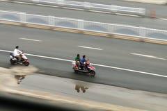 Люди на мотоциклах стоковое изображение