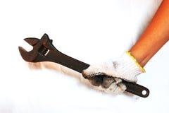 Люди нося перчатки держа ключ в белой предпосылке стоковое фото