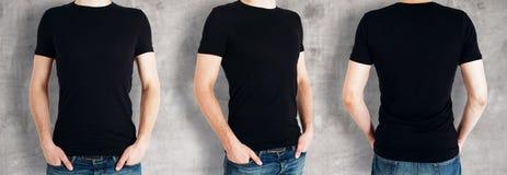 Люди нося пустую черную рубашку стоковые фото