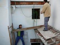 Люди работая опасно Стоковые Фото