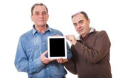 Люди с ПК таблетки стоковые фото