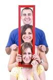 люди удерживания рамки Стоковое Фото