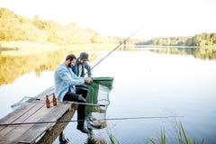 Люди удя на озере Стоковая Фотография