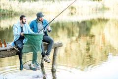Люди удя на озере Стоковое Фото