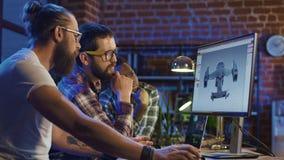 Люди coworking на графиках видеоигры Стоковые Фотографии RF