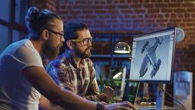 Люди coworking на графиках видеоигры Стоковая Фотография