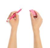 Людские руки с карандашем и erase стоковые изображения rf