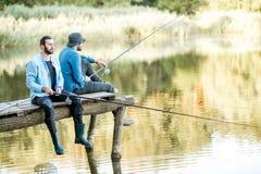 2 люд удя на озере Стоковое Фото