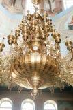 Люстра церков на стене с естественным светом золота Стоковые Изображения