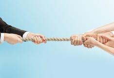Люди вручают вытягивая веревочку Стоковые Фото