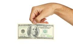 Люди вручают держать 100 долларовых банкнот на белой предпосылке Стоковое Изображение