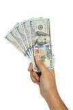 Люди вручают держать 100 долларовых банкнот на белой предпосылке Стоковые Изображения RF