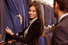 Люди в магазине костюма Стоковая Фотография RF