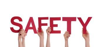 Люди держа безопасность Стоковые Фото