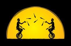 Люди жонглируя штырями пока задействующ совместно Стоковые Изображения RF