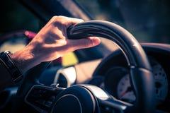 Люди за колесом Стоковая Фотография