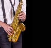 Люди играя саксофон Стоковое Изображение
