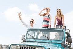 Люди и женщины в автомобиле Стоковая Фотография