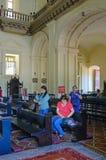 Люди идя домой после массы в католической церкви Стоковое фото RF