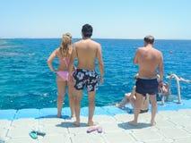 Люди наслаждаются морем Стоковое фото RF