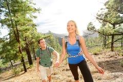Люди на походе - соедините пеший туризм в лесе Стоковое фото RF