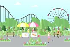 Люди отдыхают и работают в парке города с привлекательностями Стоковое фото RF
