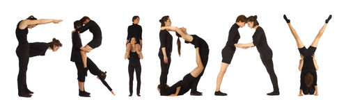Люди одетые чернотой формируя слово ПЯТНИЦУ стоковая фотография