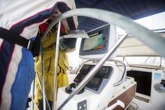 Люди при карта имея обсуждение на яхте Стоковая Фотография