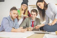 Люди проверяя телефоны Стоковая Фотография RF