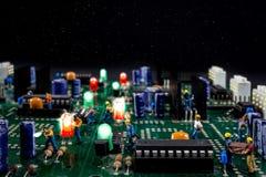 Люди работая на электронном городе Стоковое Изображение RF