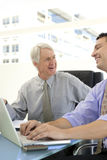 Люди смеясь над на деловой встрече Стоковые Фото