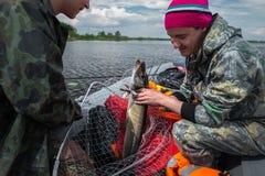 Люди с рыбой Стоковое фото RF