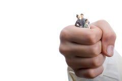 Люди Figurine модельные в руке Стоковое фото RF
