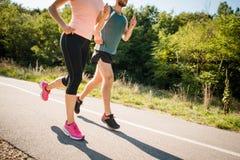 Люди jogging совместно Стоковое Изображение