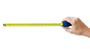 Людская рука при изолированный tape-measure Стоковая Фотография RF