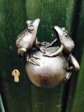 Лягушки на ручке Стоковое Фото