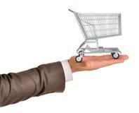 Магазинная тележкаа в руке businessmans Стоковые Фотографии RF