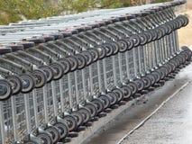 Магазинные тележкаи штабелированные и положенные вниз Стоковое Изображение