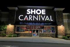 Магазин масленицы ботинка на ноче Стоковое Изображение RF