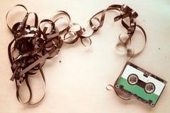 Магнитофонная кассета на запятнанной бумаге Стоковые Фотографии RF