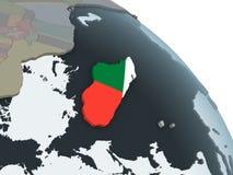Мадагаскар с флагом на глобусе иллюстрация вектора