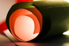 Макрос, конспект, изображение предпосылки покрашенной бумаги закручивает в спираль стоковые изображения