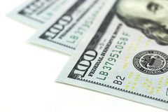 Макрос 100 долларов на белой предпосылке Стоковые Изображения RF