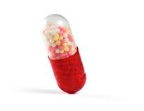 Макрос одной красной медицинской изолированной капсулы Стоковое Фото