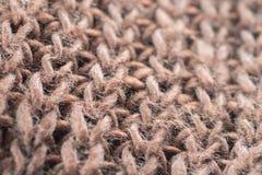 Макрос предпосылки текстуры шерстяной ткани knitwear Брайна Стоковые Фотографии RF