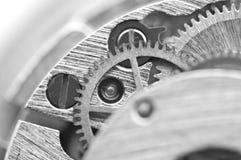 Макрос, предпосылка черноты белая с cogwheels металла Стоковое фото RF