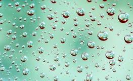 Макрос снял отражение детали банкноты долларов в падениях воды Стоковая Фотография RF